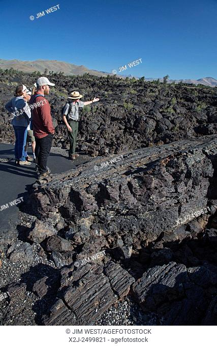 Arco, Idaho - A park ranger leads visitors on a walking tour of the cave area at Craters of the Moon National Monument