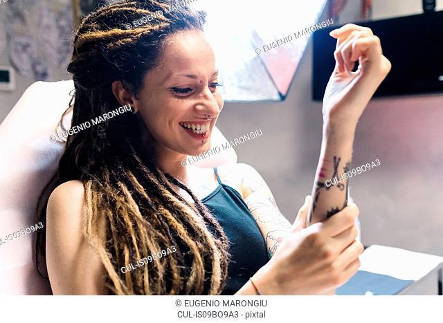 Woman in tattoo parlour