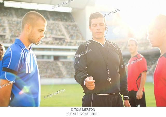 Referee tossing coin during soccer game