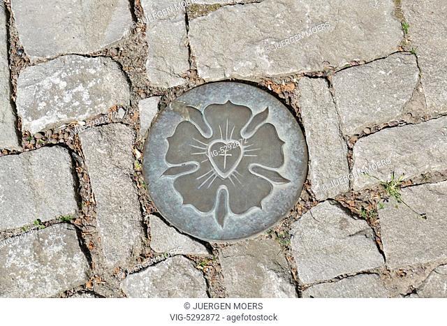 22.05.2015, Germany, Eisleben, LUTHER Rose metal plaque between paving stones. - Eisleben, Germany, 22/05/2015