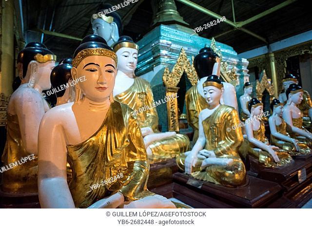 A group of Buddha statues at the Shwedagon pagoda in Yangon, Myanmar