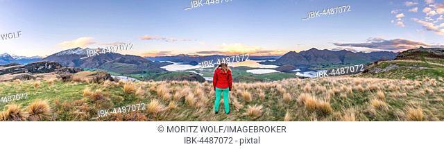 Hiker overlooking Lake Wanaka and mountains, Rocky Peak, Glendhu Bay, Otago, Southland, New Zealand