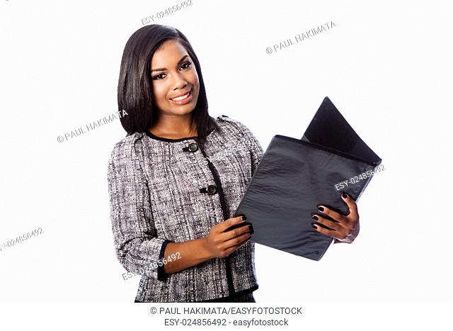 Beautiful happy smiling business woman holding portfolio binder, on white;