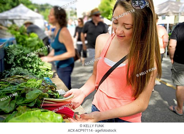 A teen girl and her mother shop at the farmer's market, downtown Kamloops, British Columbia, Thompson Okanagan region, Canada