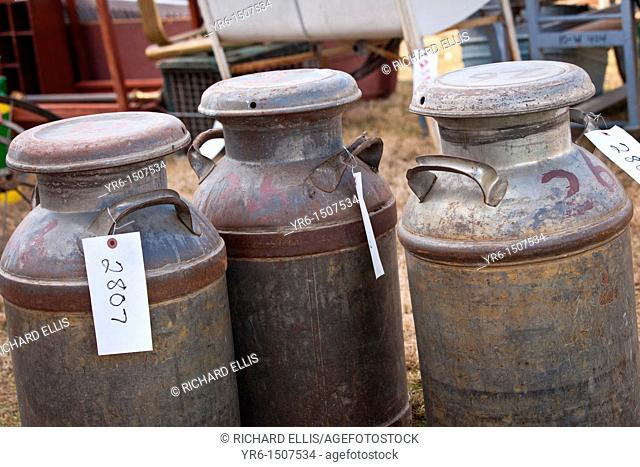 Old milk cans at auction during the Annual Mud Sale to support the Fire Department in Gordonville, PA