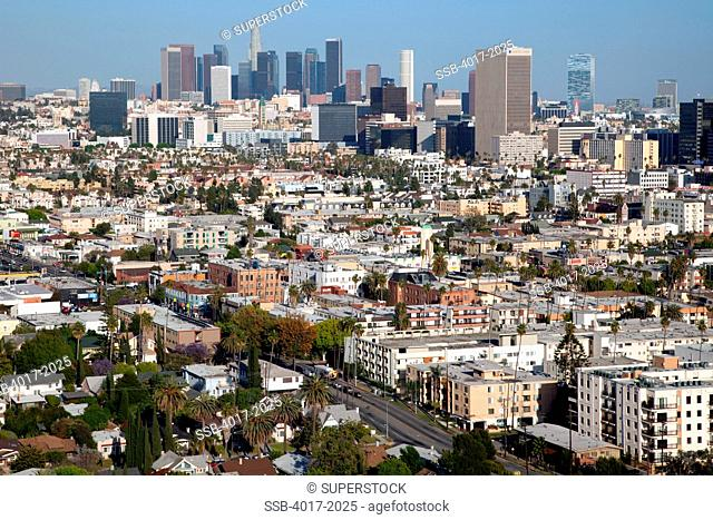 Aerial of the Mid Wilshire District and Koreatown with Downtown Los Angeles Skyline