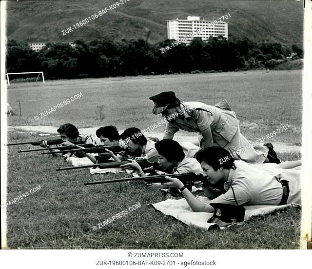 1967 - A former Wren from Cambridge teaches Hong Kong's Women Police how to shoot: Sub-Inspector Margaret Patrick with some of her women police on the rifle...