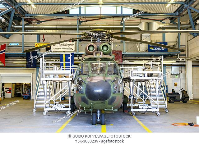 Gilze-Rijen, Netherlands. Airforce Cougar Helicopter recieving maintenance and overhaul inside the airbase's hangars. Choppers reguarty recieve maintenance