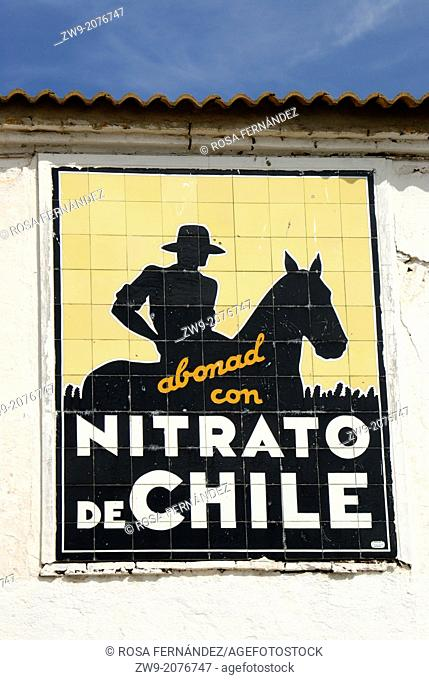 Publicity image of the Nitrato de Chile fertilizer on a wall, Andujar, province of Jaen, Andalucia, Spain