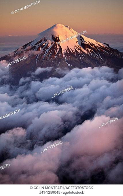 Mt Egmont / Taranaki, western flanks of dormant volcano above evening cloud, sunset, Taranaki