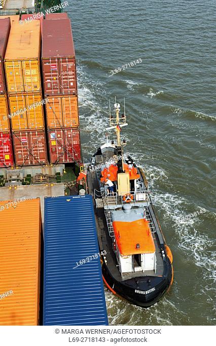 Pilot boat alongside a cargo ship on river Elbe near Brunsbüttel, Germany, Europe