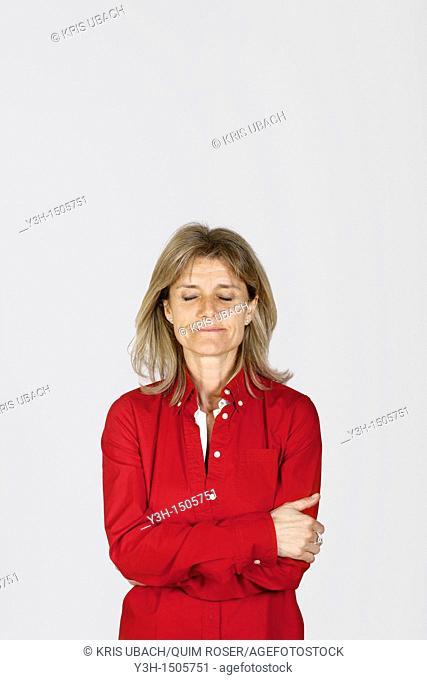 Studio shot of woman, eyes closed