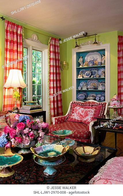 LIVING ROOMS: Bright green walls with bright raspberry accent colors, collection displays of plates on built in shelves painted bright turquoise
