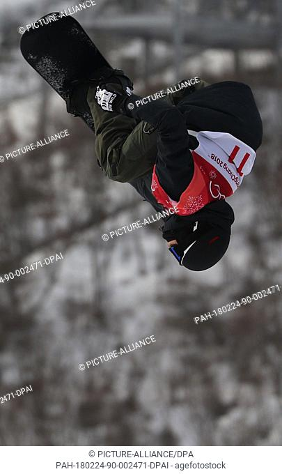 Jonas Boesiger from Switzerland performs a pirouette during the Snowboard Big Air finals in Pyeongchang, South Korea, 24 February 2018