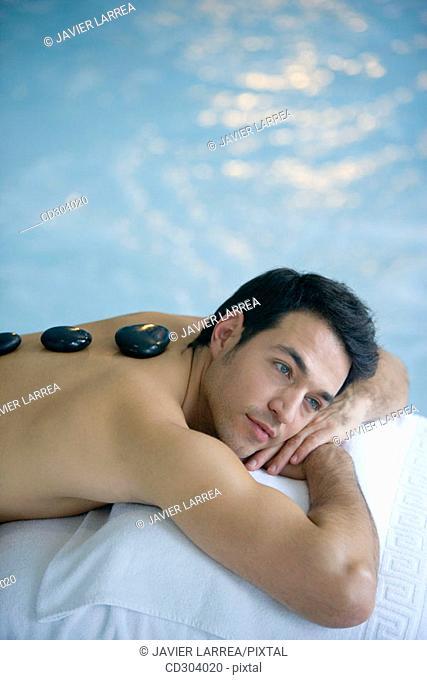 Hot stone massage. Thalassotherapy Zelai, Zumaia, Gipuzkoa, Basque Country