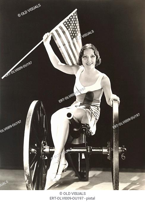 Woman on cannon holding American flag