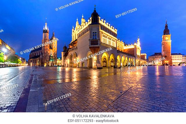 Panorama of Medieval Main market square with Basilica of Saint Mary, Cloth Hall and Town Hall Tower in Old Town of Krakow, Poland