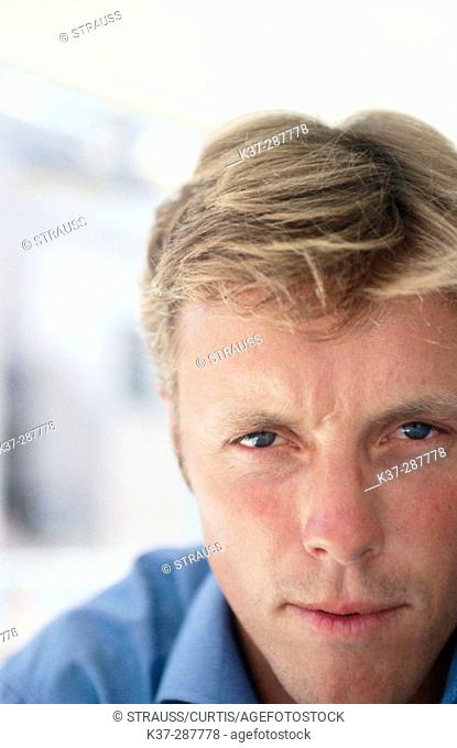 Blue eyes man portrait