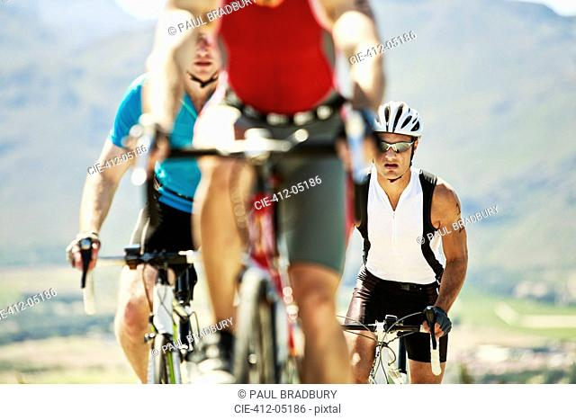 Cyclists in race in rural landscape