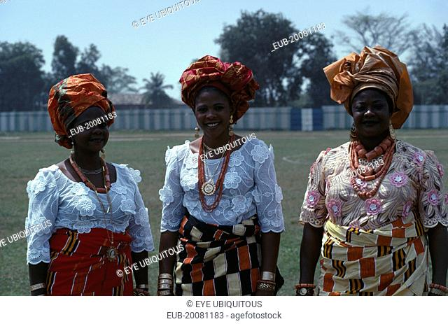 Three-quarter portrait of three Ibo women dressed in traditional clothes for special occasion