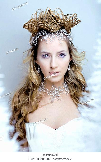 beauty young snow queen in fairy flashes with hair crown on her head close up frozen lashes, snowmaiden cold winter