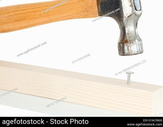 Hammer driving a nail
