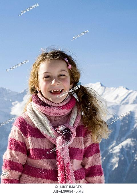 Girl laughing, Luesener Alm, Dolomite Alps, South Tyrol, Italy