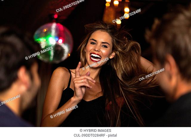 Smiling woman dancing in club