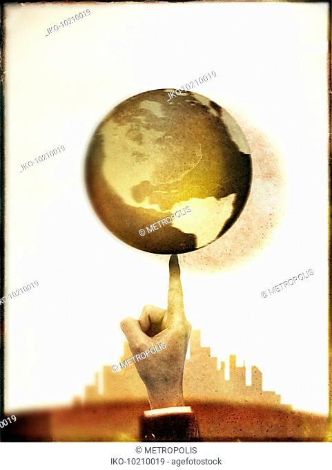 Businessman spinning globe