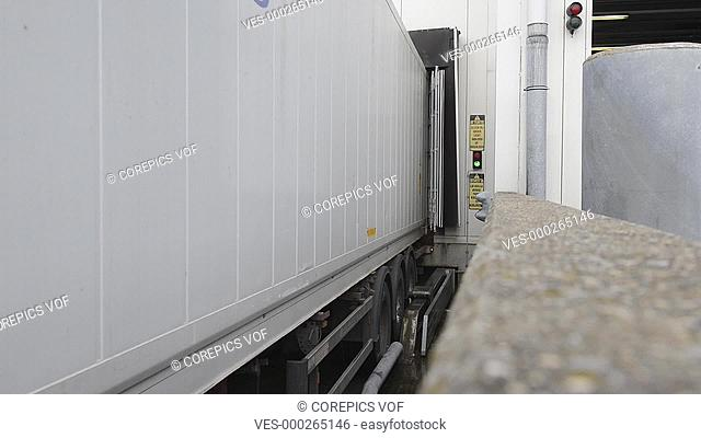 Truck, leaving the cargo doors of a distribution center