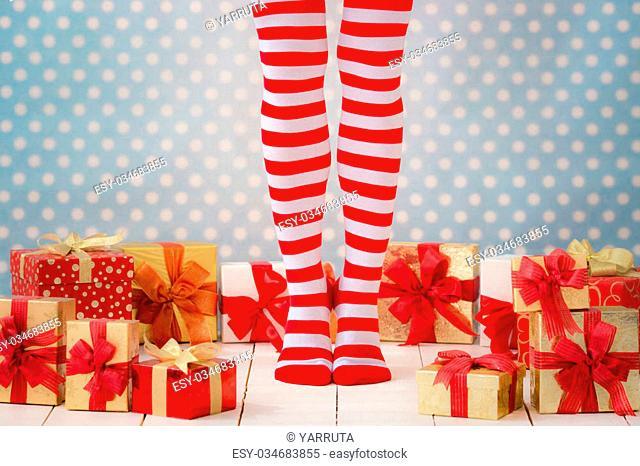 Sexy Santa woman legs. Christmas shopping concept. Xmas gift box