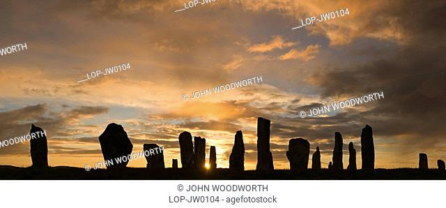 Scotland, Isle of Lewis, Callanish Outer Hebrides, A silhouette of the ancient standing stones of Callanish 1 in the Isle of Lewis