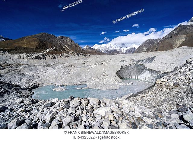 View of the Ngozumba Glacier, snow covered mountains in the distance, Gokyo, Solo Khumbu, Nepal