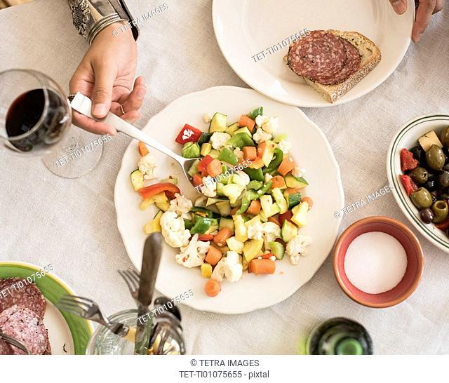 Hand serving salad