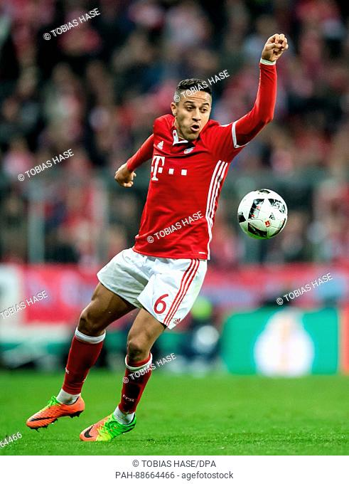 Munich's Thiago Alcantara on the ball during the DFB Cup quarter final match between Bayern Munich and FC Schalke 04 in the Allianz Arena in Munich, Germany
