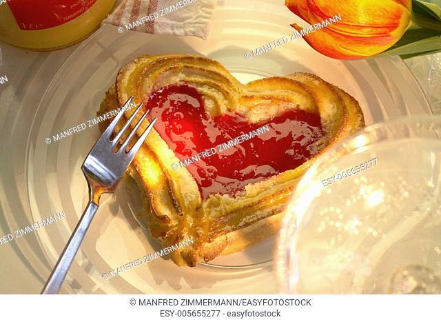 Macro Close Baeck in heart shape on coffee table