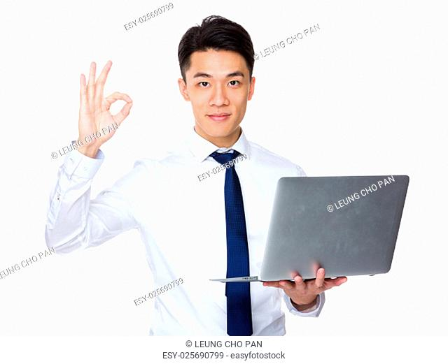 Businessman hold with laptop computer and ok sign gesture