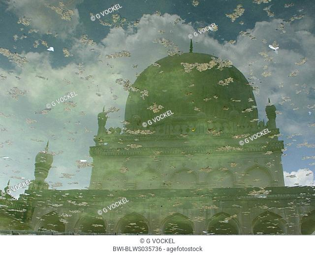 Reflection of an old tomb of a Moghul in the water of a bassin, India, Andhra Pradesh, Hyderabad