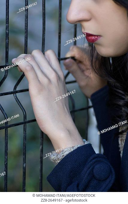 Close up of a woman hands on bars
