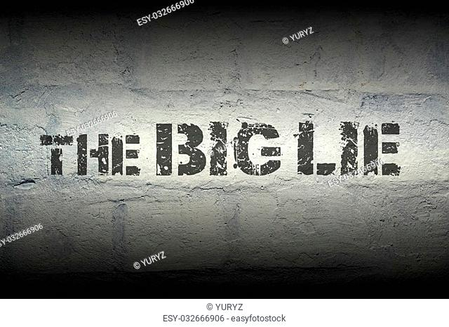 the big lie stencil print on the grunge white brick wall; specially designed font is used