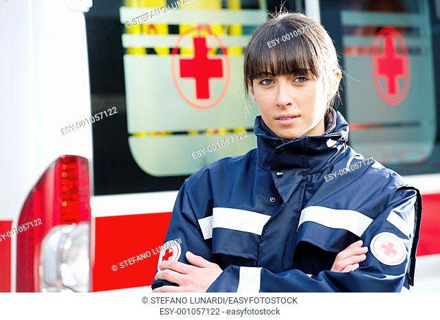 Portrait of a male paramedic, ambulance in the background