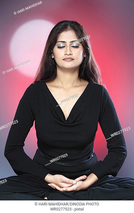 Young Indian lady meditating MR738B