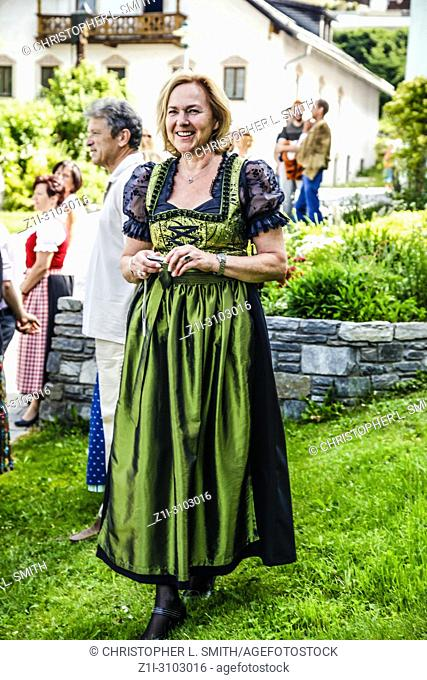 Woman in traditional austrian costume attend Patronage day in Reith bei Seefeld, Austria
