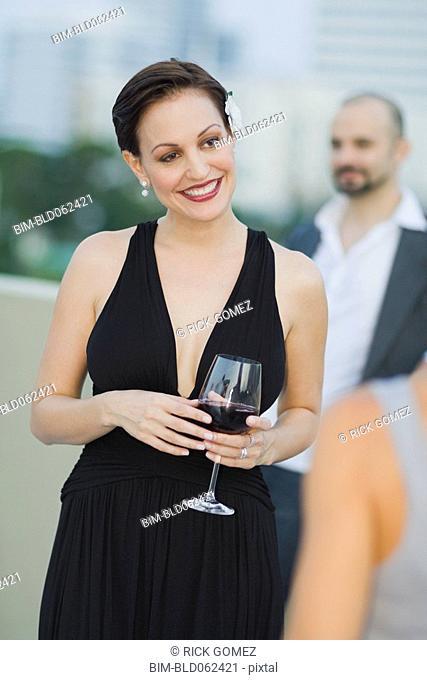 Cuban woman holding wine glass