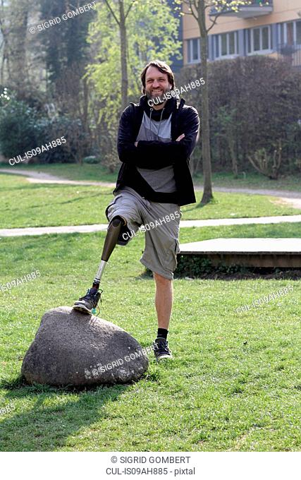 Portrait of man with prosthesis leg in park