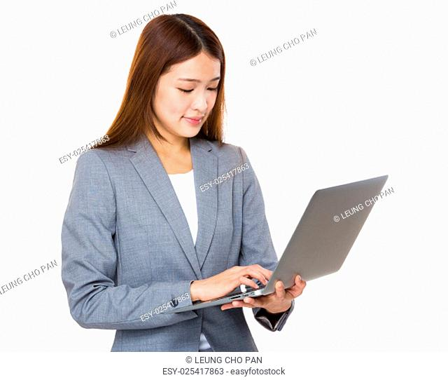 Asian businesswoman working on laptop