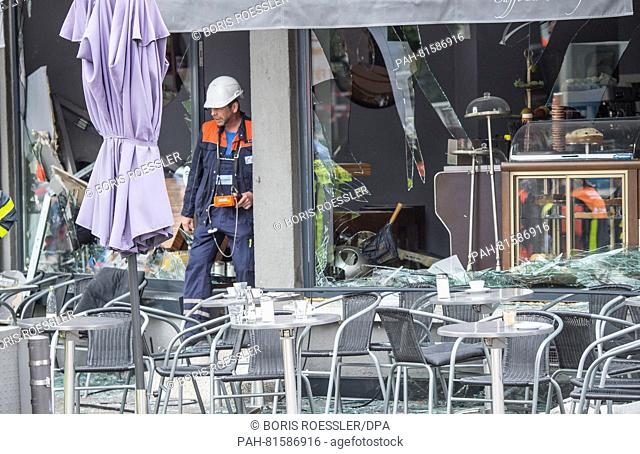 The shattered front windows of a cafe in Frankfurt am Main, Germany, 27 June 2016. According to initial investigations, a gas explosion occurred