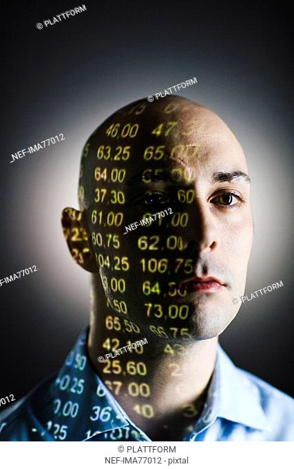 A man with the stock-exchange quotation reflected on his face