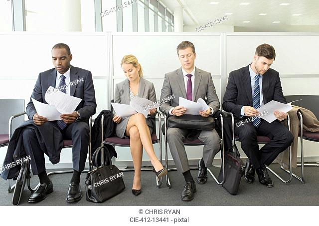 Business people reading in waiting area