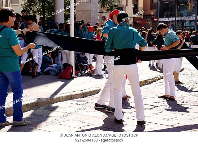 Castellers getting prepared to build a traditionally Catalan human tower. Caldes de Montbui, Barcelona, Catalonia, Spain
